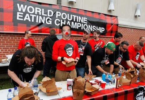 "Contestants takes part in the ""World Poutine Eating Championship"" in Toronto"